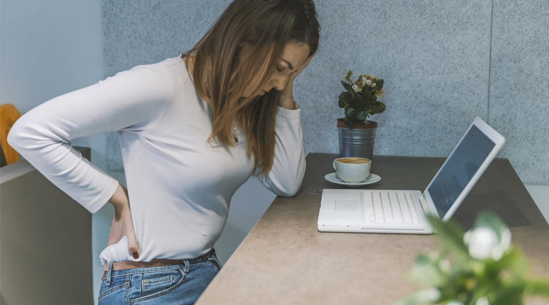 Sitting at a desk all day long can cause aches and pains. But is a standing desk really the answer?