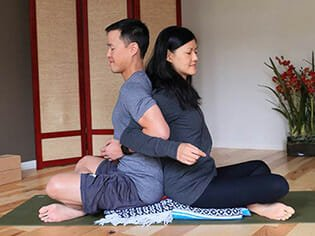 Isaac and Laura practice mindfulness and meditation techniques in a private yoga class at Yoga Mojo & Movement Therapy in Vancouver, WA