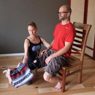 Jon practices Chair Yoga with Moriah to build strength and regain mobility while he is recovering from injury. Yoga Mojo & Movement Therapy in Vancouver, Washington