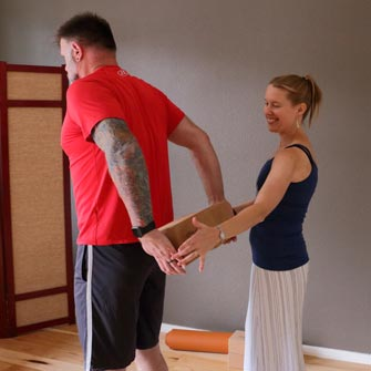 Doug learns to build strength and flexibility in a Gentle Yoga class with Moriah at Yoga Mojo & Movement Therapy in Vancouver, Washington