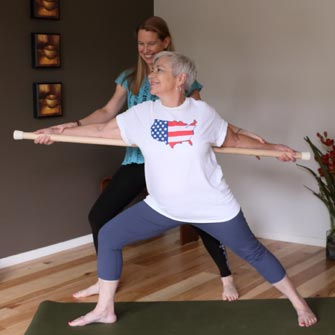 Evelyn works on balance in a Gentle Yoga class at Yoga Mojo & Movement Therapy in Vancouver, Washington