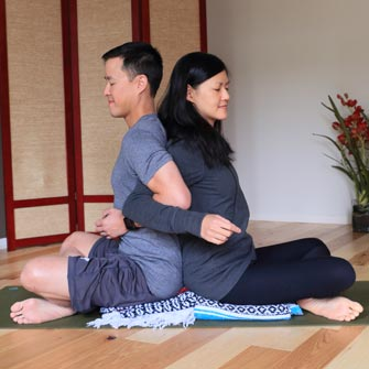 Isaac and Laura feel each other's breath during a meditation practice at Yoga Mojo & Movement Therapy in Vancouver, Washington