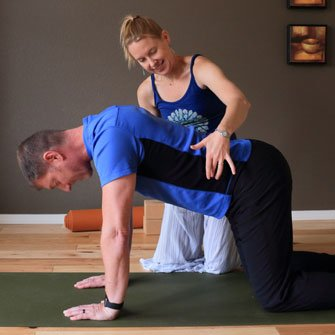 Andrew learns to move his breath into his rib cage with pranayama during a private Yoga class at Yoga Mojo & Movement Therapy in Vancouver, Washington