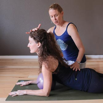 Kelly learns to breathe deeply with Pranayama techniques during her yoga class with Moriah at Yoga Mojo & Movement Therapy in Vancouver, Washington