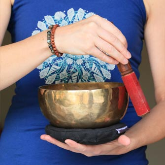 Relaxing music including Tibetan Singing Bowls is played during Restorative Yoga classes at Yoga Mojo & Movement Therapy in Vancouver, Washington