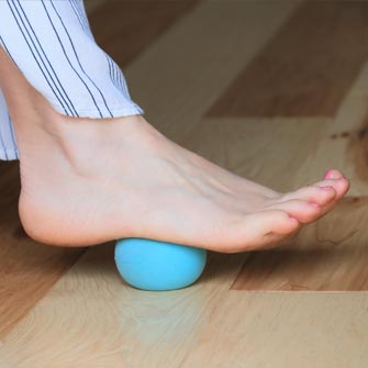 Learn self-care techniques such as foot massages with tune-up balls during a private yoga class with Moriah at Yoga Mojo & Movement Therapy in Vancouver, Washington