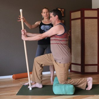 Sean builds strength practicing lunges during a yoga class at Yoga Mojo & Movement Therapy in Vancouver, WA