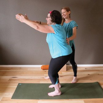 Susan enjoys a private yoga class practicing hatha flow yoga at Yoga Mojo & Movement Therapy in Vancouver, Washington