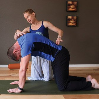 Andrew works on his back health at a yoga class in Vancouver, Washington at Yoga Mojo & Movement Therapy