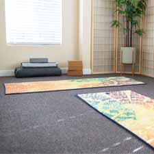 Learn yoga at a beginning yoga class in the light-filled yoga studio space at Yoga Mojo & Movement Therapy in Vancouver, WA serving all of Clark County