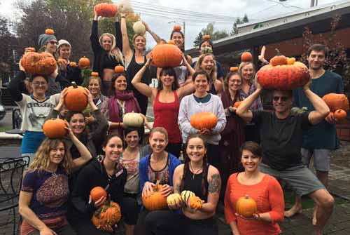 The Holistic Yoga Therapy training group at Yoga Union Community Wellness Center in Portland, Oregon learning biomechanics the Katie Bowman way