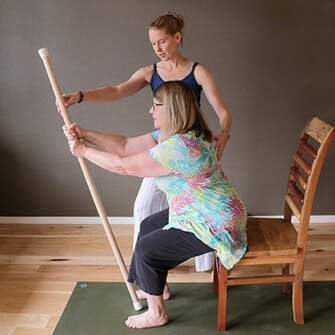 Wendy learns gentle chair yoga in Vancouver, Washington at Yoga Mojo & Movement Therapy to help increase mobility and build strength