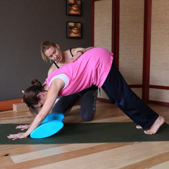 Jocelyn learns downward dog at her private yoga class in Vancouver, WA at Yoga Mojo & Movement Therapy yoga studio