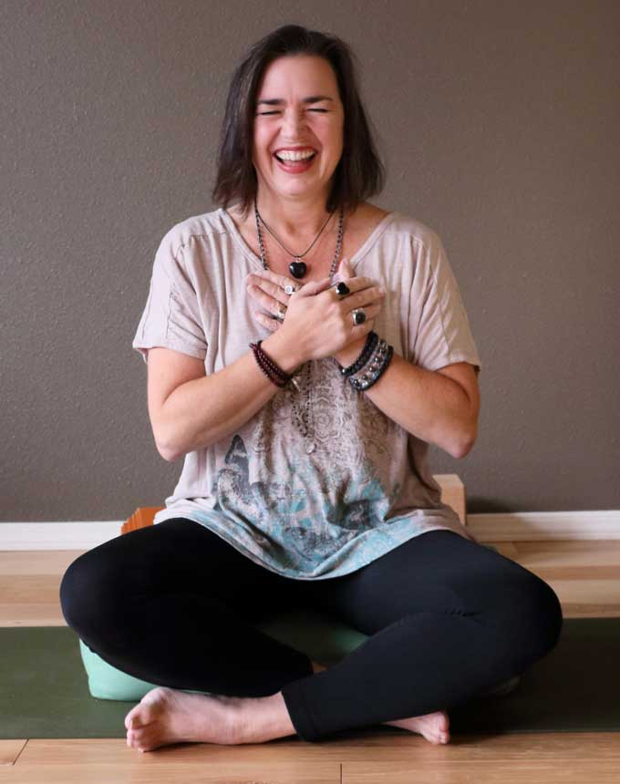 Michele practices meditation with a smile during her private yoga class in Vancouver, Washington at Yoga Mojo & Movement Therapy servicing all of Clark County including Vancouver, Washougal, Camas, Felida, Salmon Creek, Ridgefield, Battle Ground, Hockinson and La Center